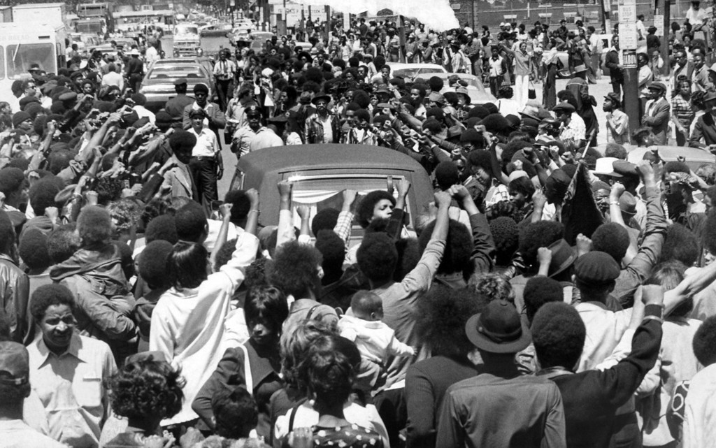 . The hearse bearing Donald DeFreeze body leaves the funeral home on the way to the cemetery on Cleveland\'s East Side in Cleveland, May 24, 1974. (AP Photo)