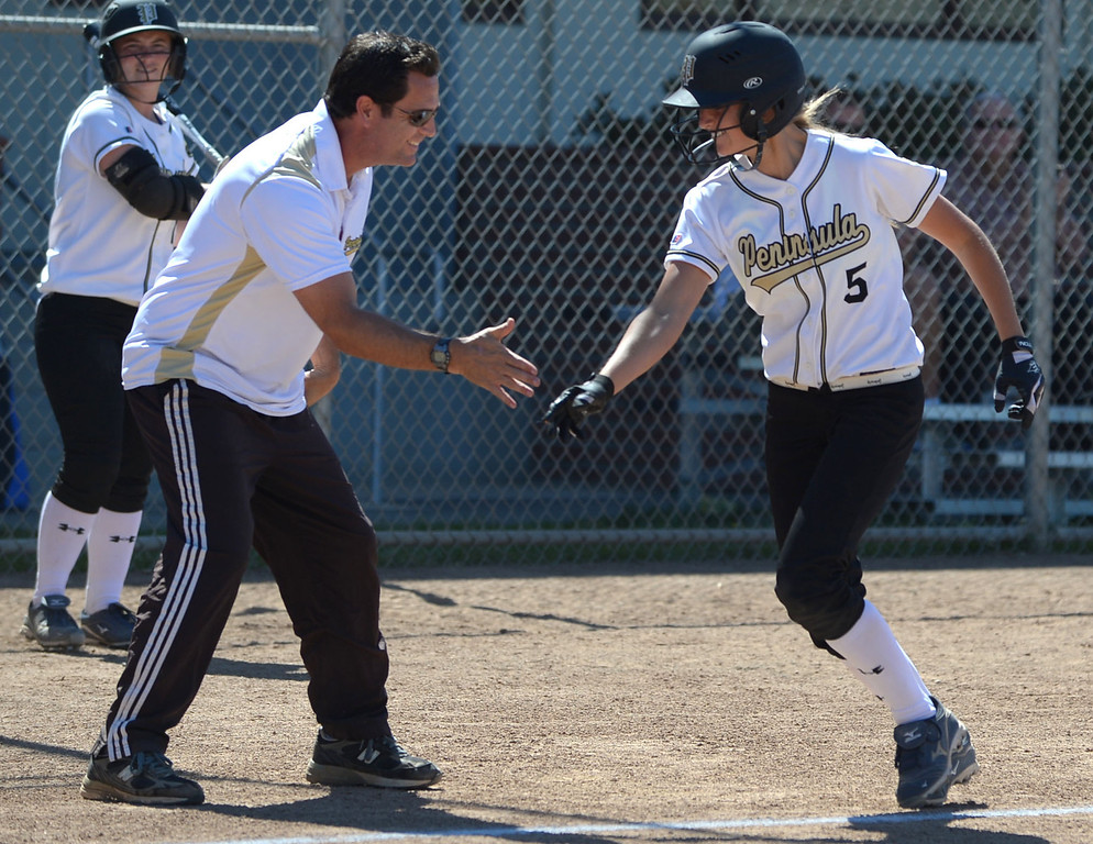 . Home Run - Peninsula\'s Brooke Christensen (5) rounds third after hitting a home run in the first inning against Arroyo Grande in a CIF Southern Section Division III wild-card softball game in Rolling Hills Estates Tuesday. Peninsula won the game 13-0. 20130514 Photo by Steve McCrank / Staff Photographer