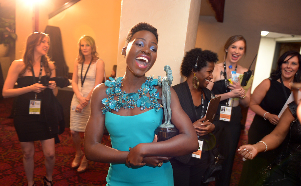 . Lupita Nyong\'o backstage at the 20th Annual Screen Actors Guild Awards  at the Shrine Auditorium in Los Angeles, California on Saturday January 18, 2014 (Photo by Michael Owen Baker / Los Angeles Daily News)