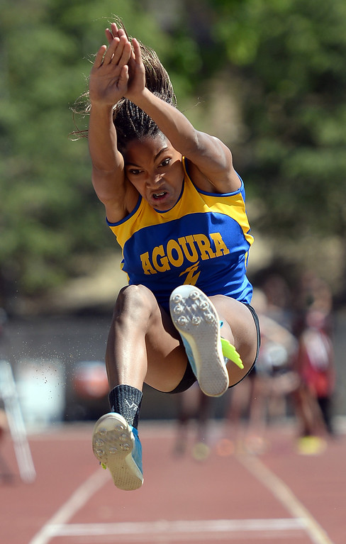 . Agoura High School\'s Tara Davis competes in the long jump during the Marmonte League track and field finals May 9, 2014 in Moorpark.(Andy Holzman/Los Angeles Daily News)