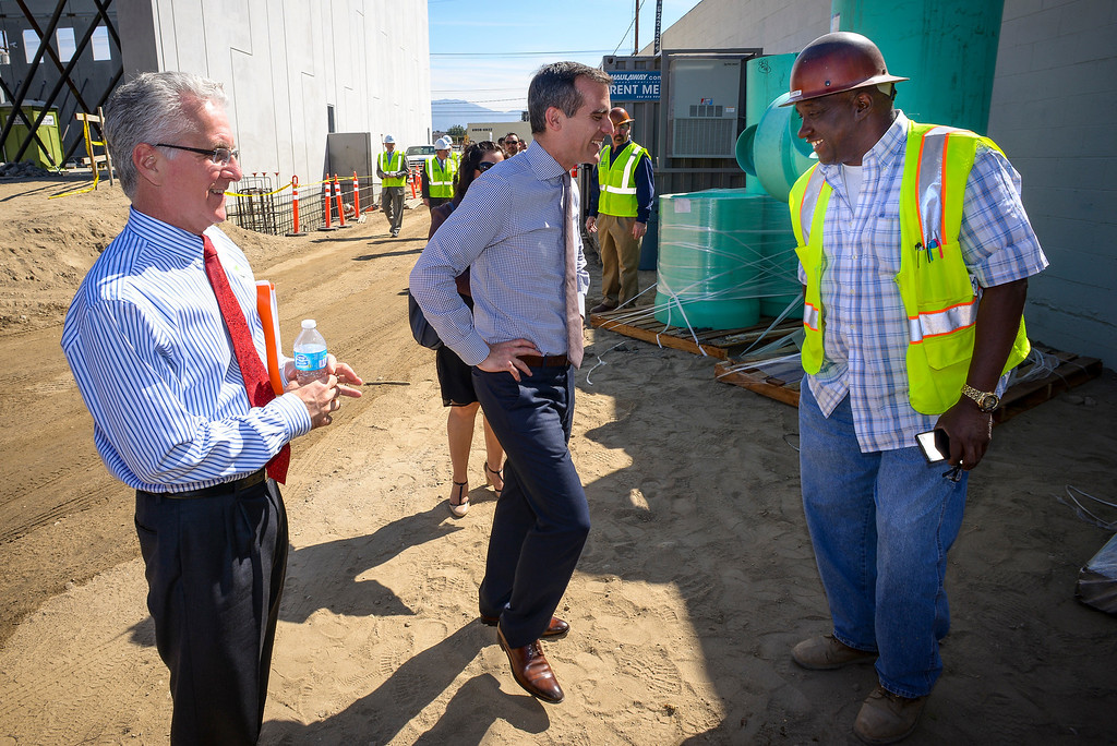 . Councilmember Paul Krekorian, left, and Los Angeles mayor Eric Garcetti chat with George Nicol at the construction site of the new Bobrick Washroom Equipment company being built in North Hollywood on Monday, March  17, 2014.   ( Photo by David Crane/Los Angeles Daily News )