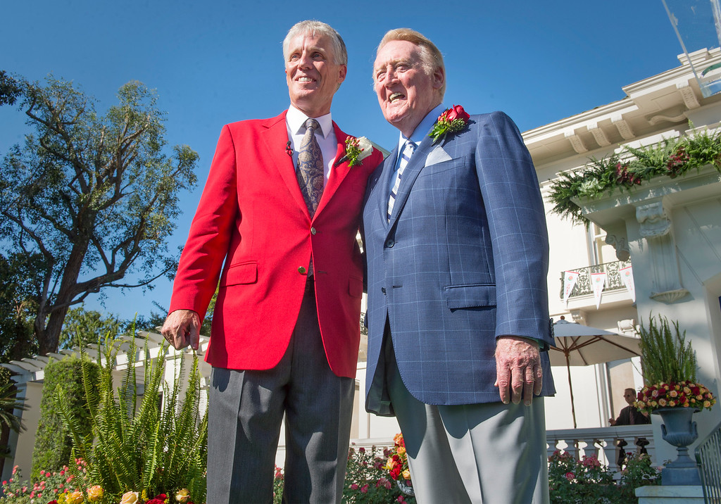 . Iconic Los Angeles Dodgers broadcaster Vin Scully, flanked by Tournament of Roses President Scott Jenkins, left, has been named as 2014 Tournament of Roses Grand Marshal the Pasadena, Calif. Tournament House Sept. 5, 2013.   (Leo Jarzomb/Pasadena Star-News)