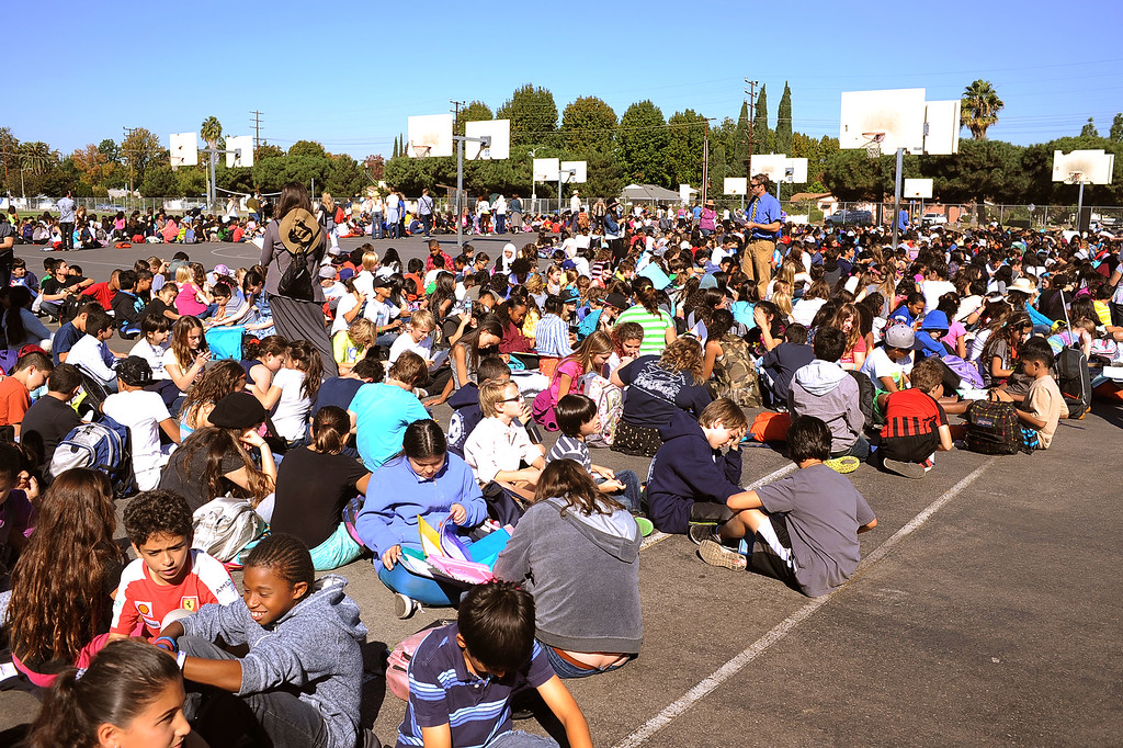 . Millikan Middle School students gather on the blacktop while participating in the Great American Shakeout in Sherman Oaks, CA, October 17, 2013.  (Andy Holzman/Los Angeles Daily News)