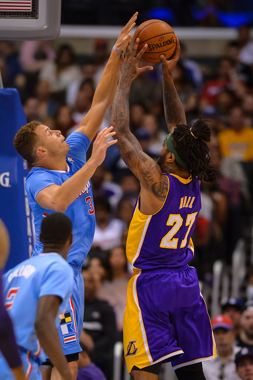 . Clippers Blake Griffin goes up to block a shot by Lakers� Jordan Hill during game action at Staples Center Sunday April 6, 2014. Clippers defeated the Lakers 120-97.  ( Photo by David Crane/Los Angeles Daily News )