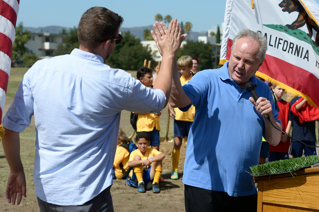 . Councilmember Tom LaBonge joined the Los Angeles Department of Recreation and Parks, LA Bureau of Engineering and a group of young soccer players to break ground on three new synthetic turf soccer fields at the Van Nuys Sherman Oaks Park. The $2.7-million renovation will include synthetic fields that can be used year round. Also planned are new paved walkways and benches. Sherman Oaks, CA. 7/1022014(Photo by John McCoy Daily News)