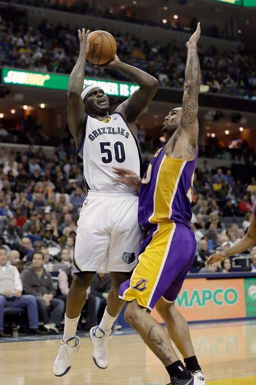 . Memphis Grizzlies\' Zach Randolph shoots over Los Angeles Lakers\' Robert Sacre during the second half of an NBA basketball game in Memphis, Tenn., Tuesday, Dec. 17, 2013. The Lakers defeated the Grizzlies 96-92. (AP Photo/Danny Johnston)