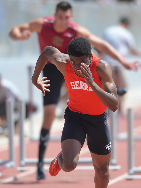 . Serra\'s Lloyd Siscard wins the 110 meter Division 4 high hurdles race of the CIF Southern Section Track and Field Championships Saturday at Mt. SAC. He would later win the 300 hurdles race as well. 20130518 Photo by Steve McCrank / Staff Photographer