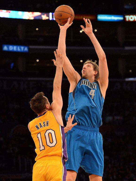 . Dallas Mavericks forward Dirk Nowitzki (41) shoots over Los Angeles Lakers guard Steve Nash (10) in the second half during an NBA basketball game in Los Angeles, Calif., on Friday, April 4, 2014. Dallas Mavericks won 107-95.  (Keith Birmingham Pasadena Star-News)