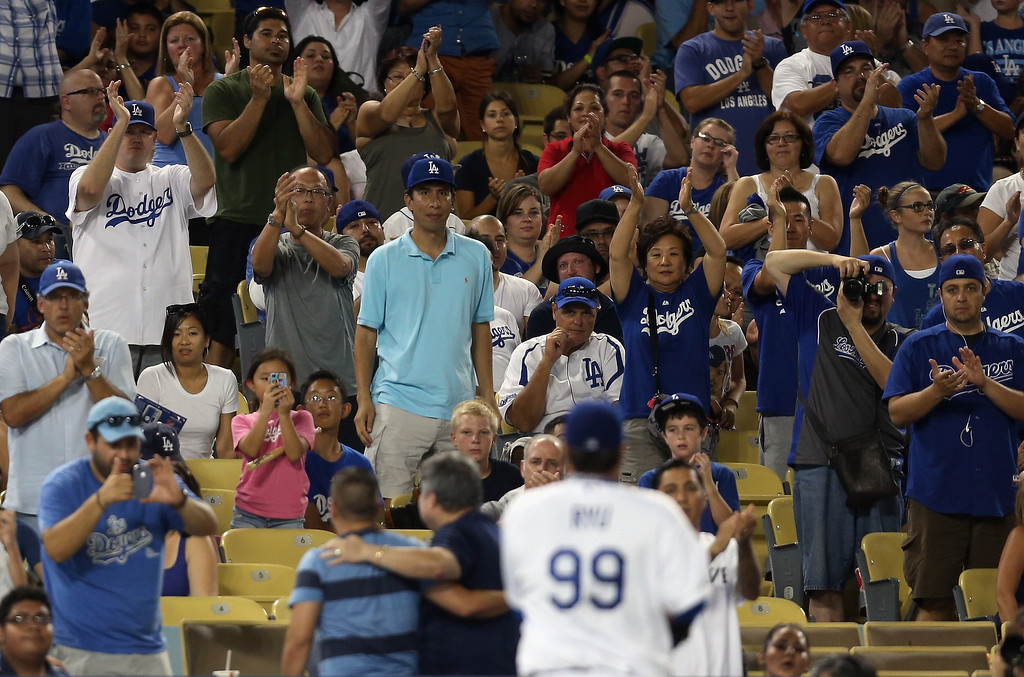 . LOS ANGELES, CA - AUGUST 30:  Fans applaud starting pitcher Hyun-Jin Ryu #99 of the Los Angeles Dodgers as he comes out of the game in the seventh inning against the San Diego Padres at Dodger Stadium on August 30, 2013 in Los Angeles, California.  (Photo by Jeff Gross/Getty Images)