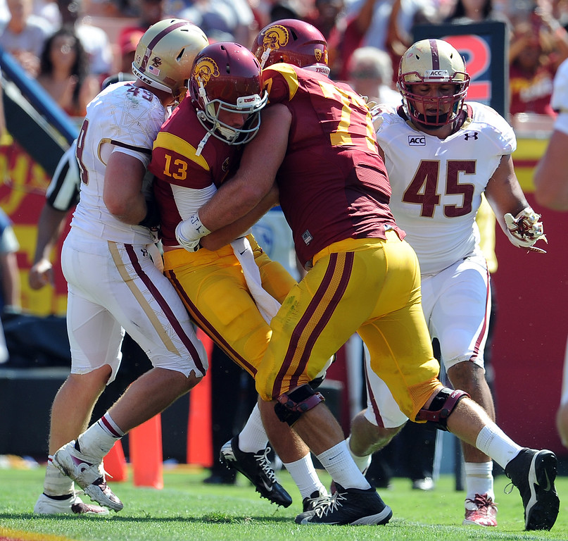 . Southern California quarterback Max Wittek (13) scrambles  for a two yard touchdown run against Boston College during the second half of an NCAA college football game in the Los Angeles Memorial Coliseum in Los Angeles, on Saturday, Sept. 14, 2013. Southern California won 35-7. 