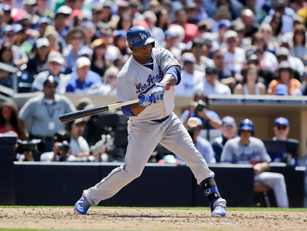. Los Angeles Dodgers\' Juan Uribe drives in the first run of a baseball game against the San Diego Padres in the seventh inning in San Diego, Sunday, June 23, 2013. (AP Photo/Lenny Ignelzi)