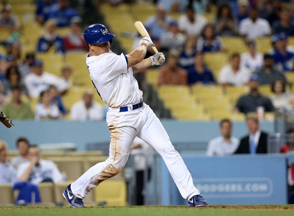 . Mark Ellis #14 of the Los Angeles Dodgers  hits a two run double in the eighth inning against the Colorado Rockies at Dodger Stadium on July 11, 2013 in Los Angeles, California.  Dodgers won 6-1.   (Photo by Stephen Dunn/Getty Images)
