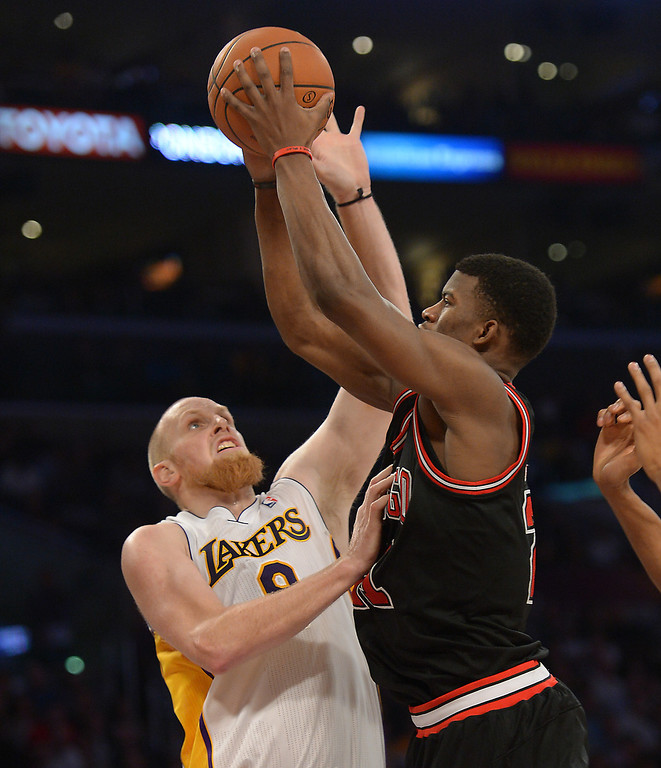 . Los Angeles Lakers\' Chris Kaman guards Chicago Bulls\' Jimmy Butler in the NBA basketball game at Staples Center in Los Angeles, CA. on Sunday, February 9, 2014. (Photo by Sean Hiller/ Daily Breeze).