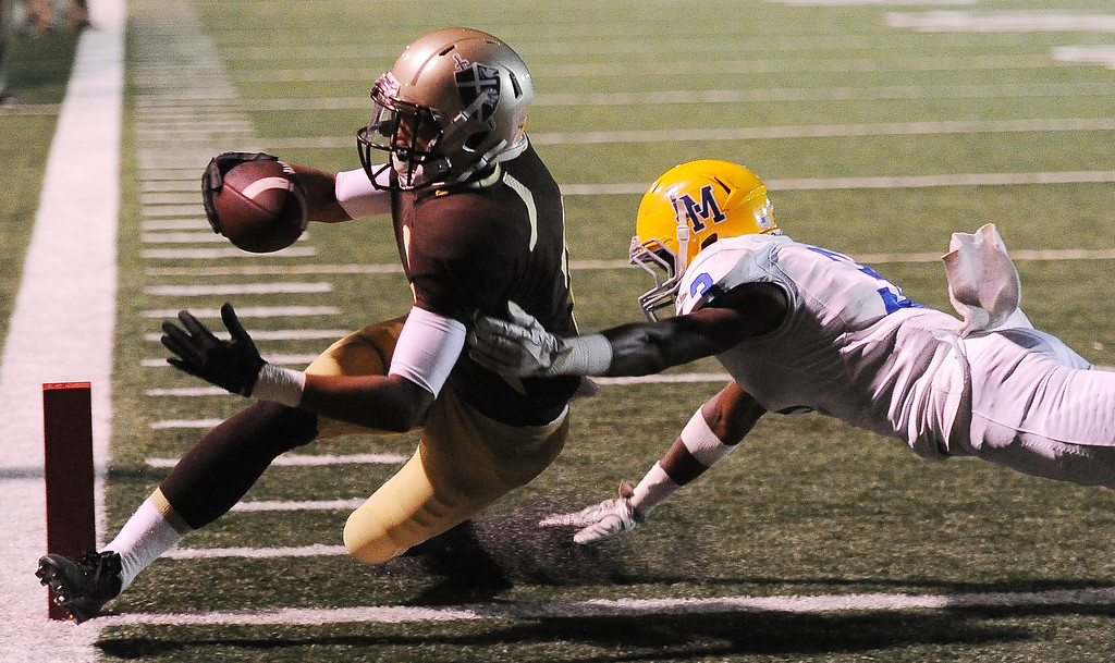 . St. Francis\' Dylan Crawford (2) runs for a touchdown past La Mirada\'s D\'ante Smith (3) in the first half of a prep football game at St. Francis High School in La Canada, Calif. on Thursday, Sept. 19, 2013.    (Photo by Keith Birmingham/Pasadena Star-News)