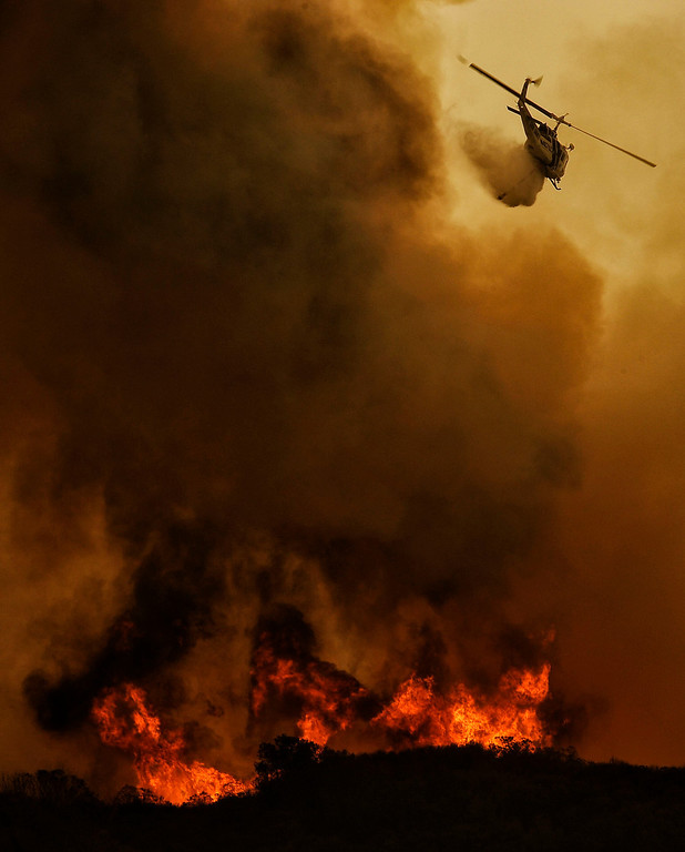 . A firefighting helicopter makes a drop on the  Springs Fire along W Potrero Rd in Thousand Oaks Friday, May 3, 2013. (Hans Gutknecht/LA Daily News)
