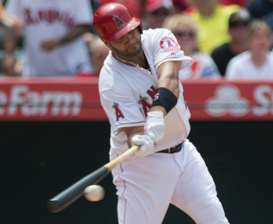 . Angels\' Albert Pujols gets a hit as they play the Minnesota Twins at Angel Stadium in Anaheim on Thursday June 26, 2014. The Angels beat the Minnesota Twins 6-4. (Photo by Keith Durflinger/Whittier Daily News)