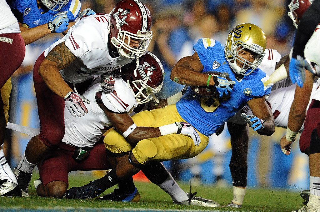 . UCLA running back Jordon James (6) runs for a touchdown against New Mexico State during the first half of their college football game in the Rose Bowl in Pasadena, Calif., on Saturday, Sept. 21, 2013.   (Keith Birmingham Pasadena Star-News)