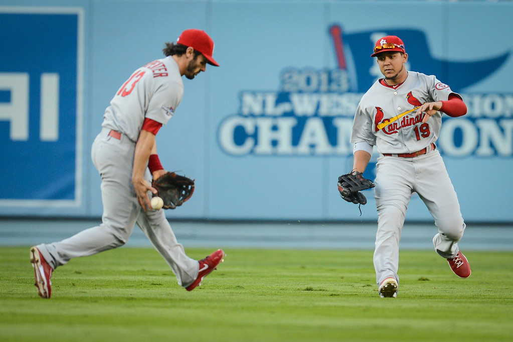 . Cardinals\' Matt Carpenter and Jon Jay dropped the ball allowing the Dodgers to go on to score in game 3 of the NLCS Monday October 14, 2013 ( Photo by Hans Gutknecht/Los Angeles Daily News )