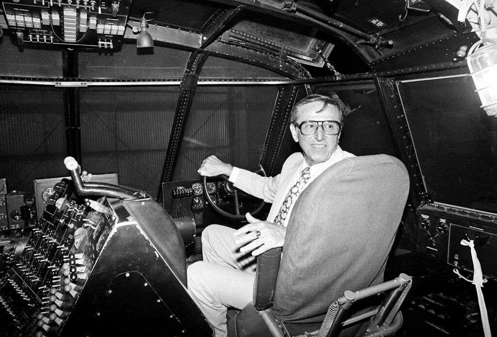 """. Dave Grant, co-pilot for Howard Hughes when the millionaire took his massive flying boat known as the \""""Spruce Goose\"""" aloft for its only flight on Nov. 2, 1947, sits in his old seat in the craft\'s cockpit on July 28, 1980, in Long Beach, Calif. Grant was a hydraulic engineer who did not have a pilot\'s license when serving as Hughes\' co-pilot. (AP Photo/ Rasmussen)"""