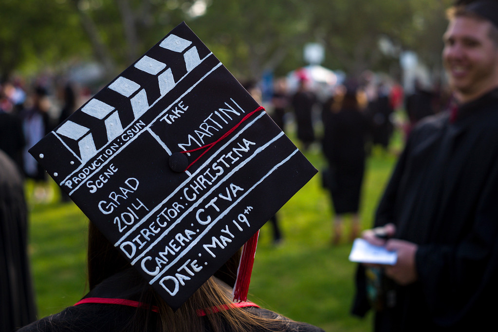 . Christina Young, a CSUN graduate in Television and Film arts turned her mortar board into a clap board for her graduation at Cal State Northridge Monday, May 19, 2014.  ( Photo by David Crane/Los Angeles Daily News )