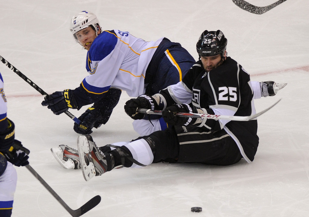 . The Kings\'  Dustin Penner and St. Louis Blues Jaden Schwartz hit the ice in the second period, Monday, May 6, 2013, at Staples Center. (Michael Owen Baker/Staff Photographer)
