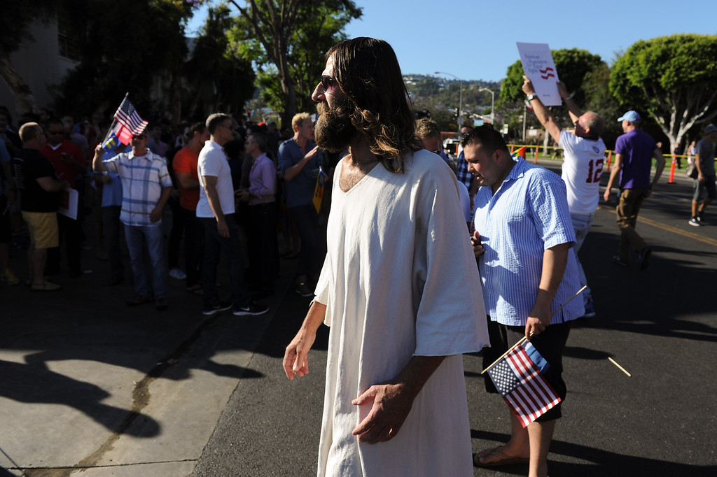 . A man dressed as Jesus attends the rally in West Hollywood to celebrate the U.S. Supreme Court\'s ruling that killed Prop 8, Wednesday, June 26, 2013. (Michael Owen Baker/L.A. Daily News)