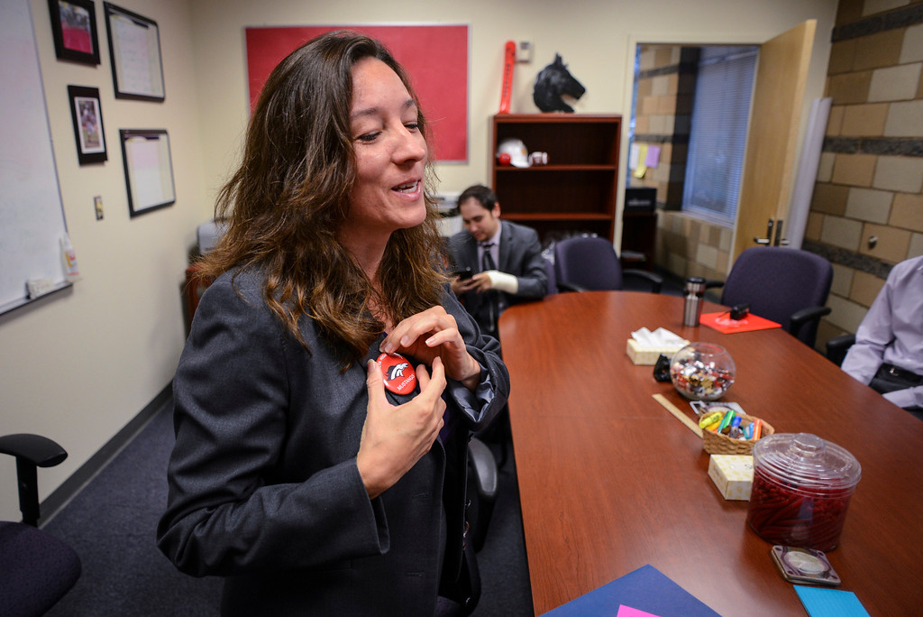 . Newly elected LAUSD school board member Monica Ratliff puts on a Mustang pin during a tour of Arleta high school.  Tuesday is the first day of school for the Los Angeles Unified School District. Photo by David Crane/Los Angeles Daily News