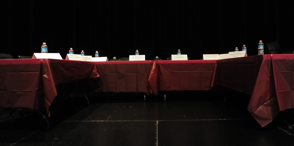 . Empty board members seats after 25 plus spoke on his behalf and over 200 people crowded the Arcadia Unified School District Performing Arts Center as a show of support for fired Arcadia High School cross-country coach James O\'Brien during a Arcadia Unified School District Board of Education meeting on Tuesday, July 23, 2013 in Arcadia, Calif. O\'Brien, led the team to two time state and national championships.  (Keith Birmingham/Pasadena Star-News)