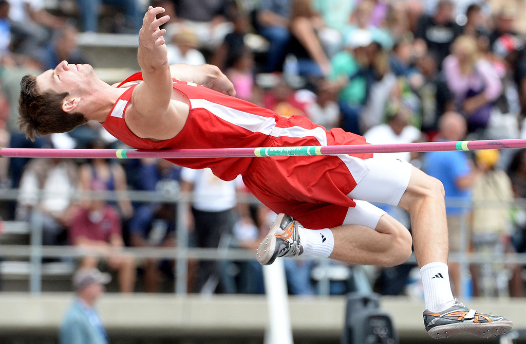 . Corona\'s Tanner Behrens competes in the division 1 high jump during the CIF Southern Section track and final Championships at Cerritos College in Norwalk, Calif., Saturday, May 24, 2014. 