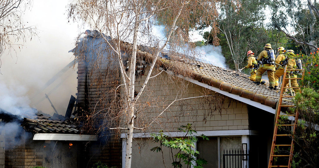 . Los Angeles County Firefighters battle a fire that damaged a single family home. The fire started in the garage along the 1300 block of Via Verde. No injuries, but 5 cars were destroyed including two jaguars in San Dimas, Calif., on Saturday, Jan.4, 2014.   (Keith Birmingham Pasadena Star-News)