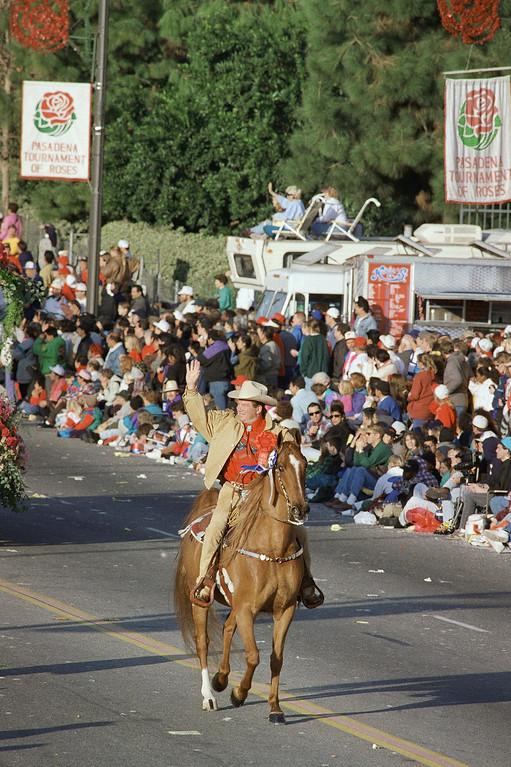 . William Shatner waves to the crowd as he leads the 105th Tournament of Roses parade as Grand Marshall in Pasadena, California on Jan. 1, 1994. Know as the Starship Enterprise\'s legendary James T. Kirk, Shatner off screen is a dedicated horse breeder. (AP Photo/Doug Pizak)