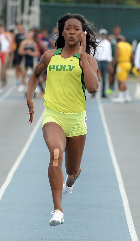 . Long Beach Poly\'s Arianna Washington wins the division 1 100 meter dash during the CIF Southern Section track and final Championships at Cerritos College in Norwalk, Calif., Saturday, May 24, 2014. 