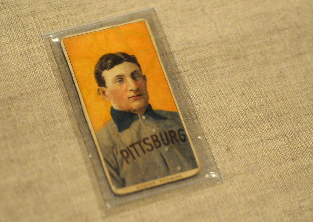 """. One of the most prized treasures in baseball is this Honus Wagner baseball card, included in the \""""Baseball!\"""" exhibit.The Exhibition opens April 4, 2014 at the Ronald Reagan Presidential Library and Museum.  Running through September 4, 2014, Baseball is a 12,000 square foot exhibition featuring over 700 artifacts, including some of the rarest, historic and iconic baseball memorabilia.  (Photo by Dean Musgrove/Staff Photographer)"""