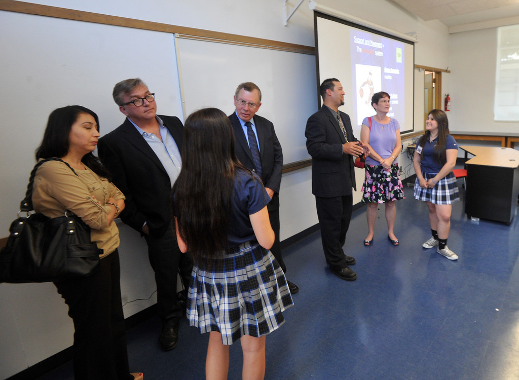 . School officials, students and guests tour the new $650,000 Science Center at St. Paul High School in Santa Fe Springs on Thursday May 2, 2013. The Science Program and Technology Infrastructure will enable the school to offer state-of-the-art science programs. (SGVN/Staff Photo by Keith Durflinger)