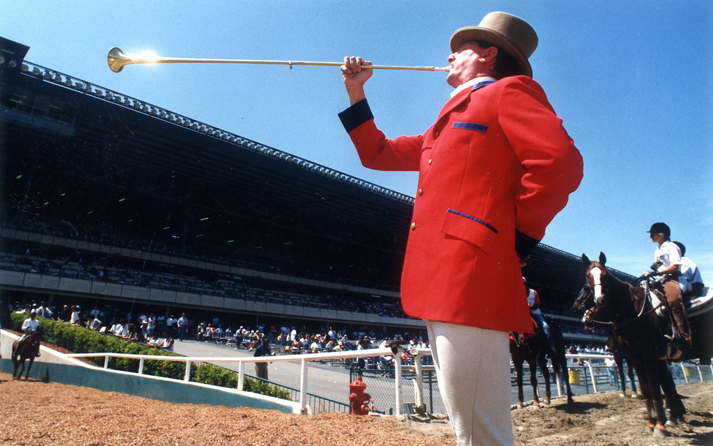 . The sounds of Jay Cohen bring the horses on the tack for a race during opening day at Hollywood Park on 4/21/93.   (Los Angeles Daily News file photo)