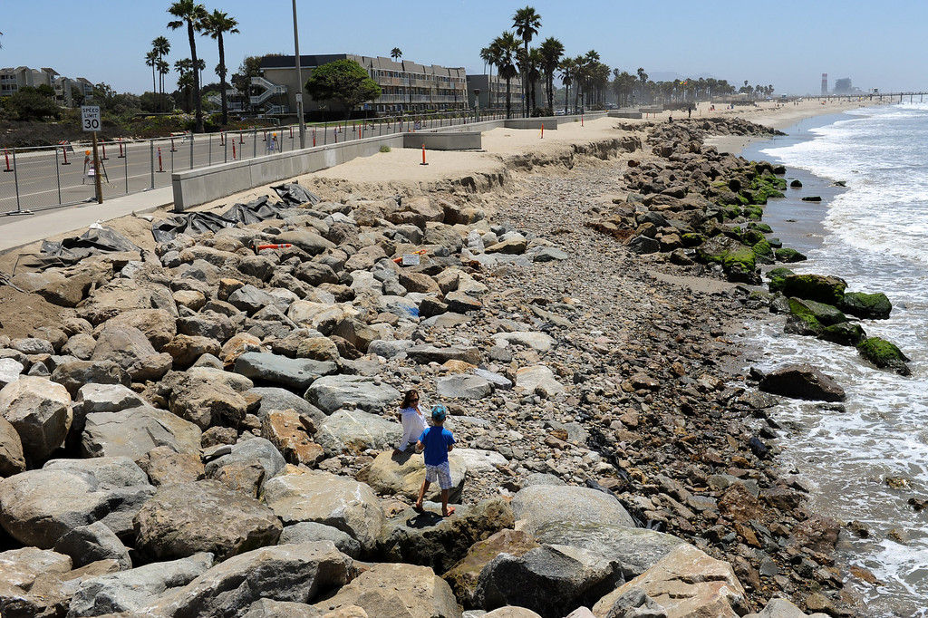 . Officials are planning to install boulders along Hueneme Beach, as sand has washed away during the past several months, an issue usually mitigated by dredging every two years. But as dredging gets more expensive and funding decreases, less sand has been moved to the beach. As a result, a rapidly eroding shoreline now threatens Surfside Drive. Monday, July 15, 2013. (Michael Owen Baker/L.A. Daily News)
