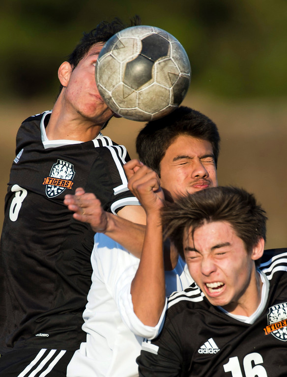 . Monrovia\'s Antonio Rosas (9) goes up for the ball against South Pasadena\'s Justin Fernandez (8) and Clem Witherall (16) in the first half of Boys soccer, South Pasadena at Monrovia on Wednesday, Jan. 8, 2013. Monrovia won 5-1. (Photo by Watchara Phomicinda/ Pasadena Star-News)