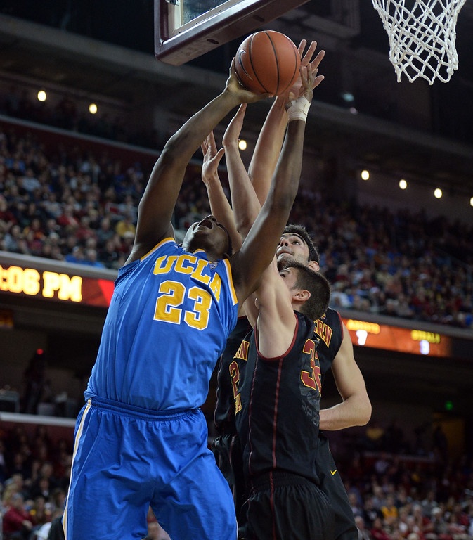 . UCLA\'s Tony Parker (23) fights for the rebound against Southern California in the first half of a PAC-12 NCAA basketball game at Galen Center in Los Angeles, Calif., on Saturday, Feb. 8, 2014. (Keith Birmingham Pasadena Star-News)
