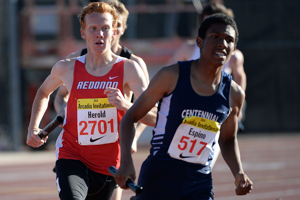 . Redondo Union\'s Dustin Herold competes in the 4x800 Invitational during the Arcadia Invitational track and field meet at Arcadia High School in Arcadia, Calif., on Friday, April 11, 2014. Rocky Mountain won the race as Redondo Union finished second. (Keith Birmingham Pasadena Star-News)