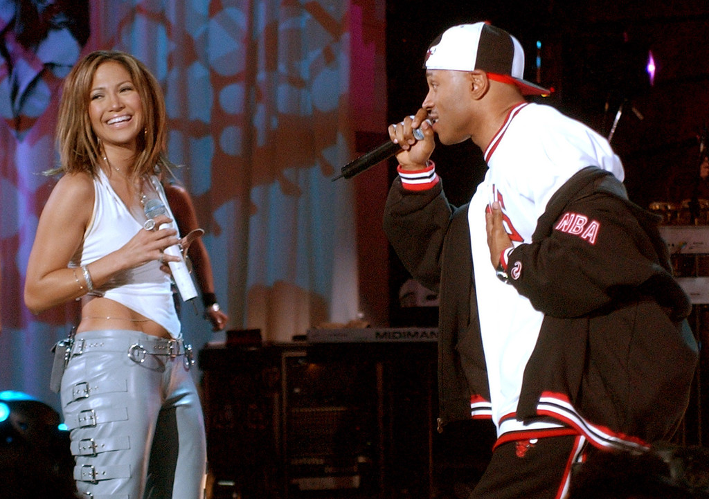 ". Jennifer Lopez smiles as she sings a duet with LL Cool J  at the Kips Bay Boys and Girls Club in the Bronx borough of New York, during NBC\'s ""Today\"" morning televison program appearance Friday Dec. 6, 2002. (AP Photo/Richard Drew)"