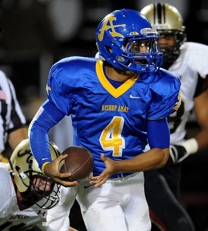 . Bishop Amat quarterback Koa Haynes (C) scrambles against Alemany in the first half of a prep football game at Bishop Amat High School in La Puente, Calif., on Friday, Oct. 25, 2013.    (Keith Birmingham Pasadena Star-News)