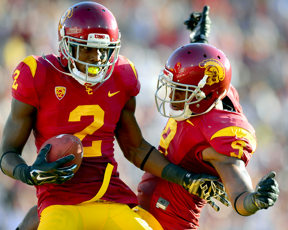 . USC WR Adoree\' Jackson, left, celebrates his 18-yard touchdown pass with JuJu Smith, Saturday, August 30, 2014, at the L.A. Memorial Coliseum. (Photo by Michael Owen Baker/Los Angeles Daily News)
