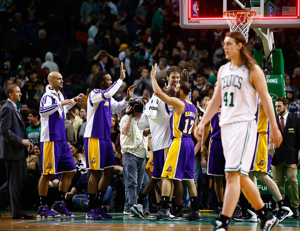 . BOSTON, MA - JANUARY 17: Members  of the Los Angeles Lakers celebrate their 107-104 win against the Boston Celtics during the game at TD Garden on January 17, 2014 in Boston, Massachusetts.   (Photo by Jared Wickerham/Getty Images)