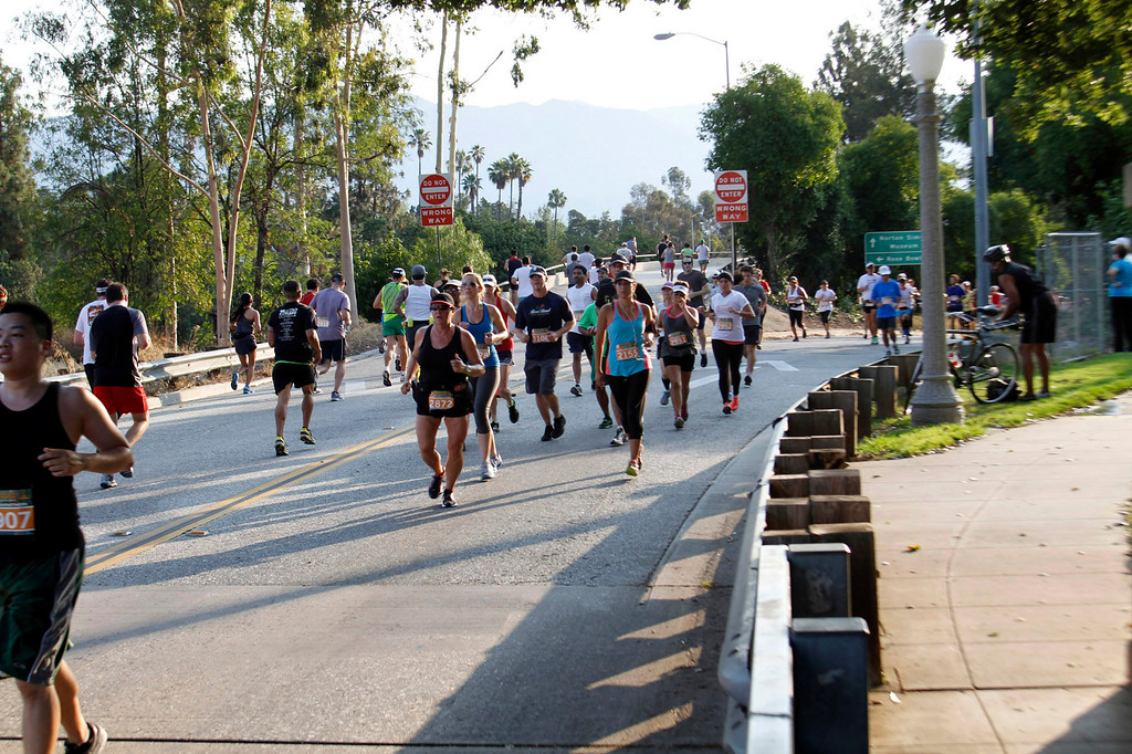 . Participants run through the Pasadena area during the 5th Annual Pasadena Marathon Event, in Pasadena, Sunday, June 30, 2013. (SXCITY/Correspondent Photo by James Carbone)