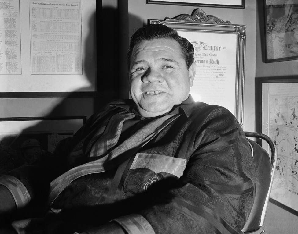 . Babe Ruth, greatest figure of baseballs\' modern age, has given up hope of ever returning to the game he glorified for two decades. The Babe, born George Herman Ruth almost 46 years ago, is shown taking life easy amidst countless trophies of his baseball prowess.    (AP Photo)