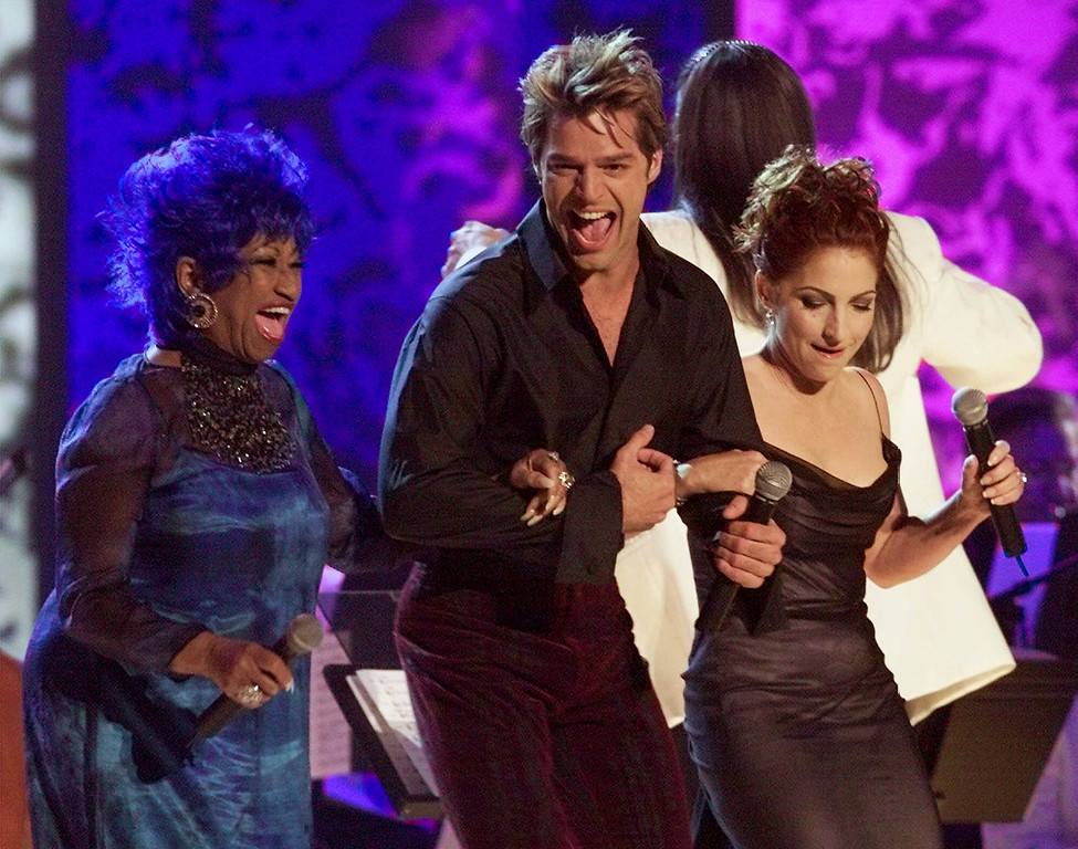 . From left, Celia Cruz, Ricky Martin and Gloria Estefan perform during the opening moments of the first annual Latin Grammy Awards in Los Angeles, Wednesday, Sept. 13, 2000. (AP Photo/Kevork Djansezian)