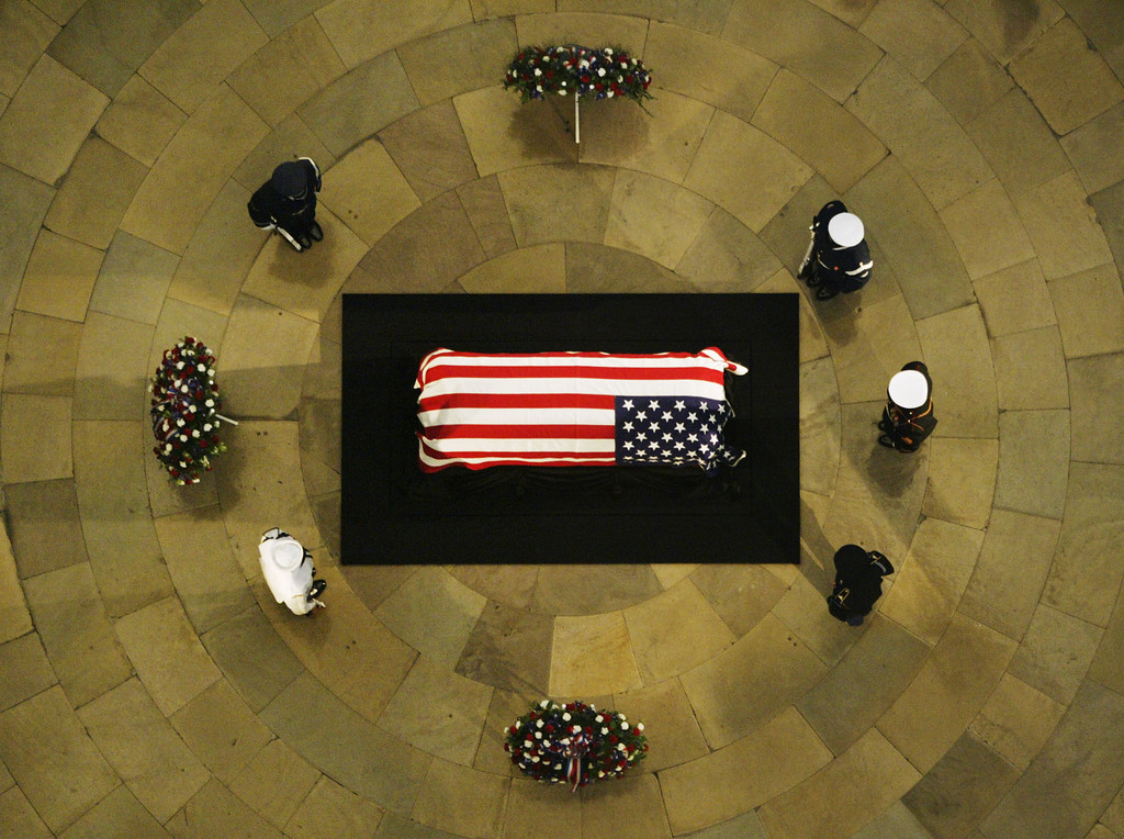 . Members of the military honor guard stand on duty by the casket of former U.S. President Ronald Reagan Thursday, June 10, 2004 in Washington, DC.  Funeral services for Ronald Reagan were held at the National Cathedral in Washington Friday, June 11, 2004.  (AP Photo/Stephan Savoia)