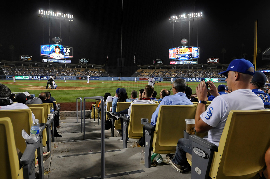 . New big screens in the outfield, and premium seating behind home plate add to the fan experience. Fans at Dodger Stadium have been treated to a lot of excitement. The Dodgers defeated the New York Mets 5-4 in 12 innings Wednesday night at Dodger Stadium in Los Angeles, CA. 8/14/2013  (John McCoy/LA Daily News)