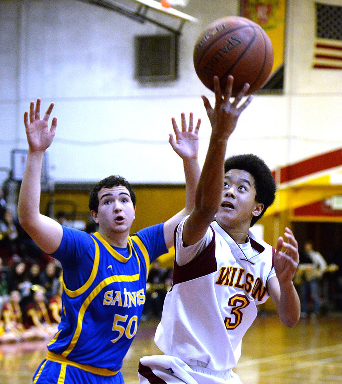 . Wilson\'s Kyle Price (3) drives to the basket past San Dimas\' Omar Nasri (50) in the first half of a prep basketball game at Wilson High School in Hacienda Heights, Calif., on Friday, Jan. 31, 2014. (Keith Birmingham Pasadena Star-News)