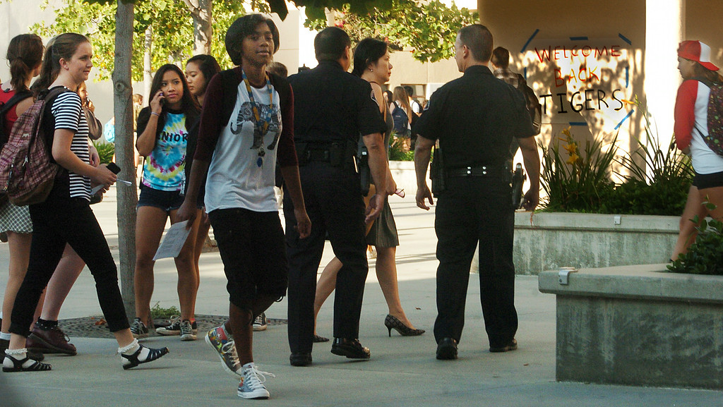 . A Welcome Back Tigers sign on wall, as two police officers patrol the South Pasadena High School campus on first day back to school Thursday, August 21, 2014. This the the campus where a 16- and 17-year-old boy allegedly planned a mass shooting to kill three staff members and as many students as possible, Police Chief Arthur Miller said. The Los Angeles County District Attorney\'s Office on Wednesday charged both boys with one count of making criminal threats. The D.A. has not charged the teens for conspiracy to commit a mass shooting, just a shooting. (Photo by Walt Mancini/Pasadena Star-News)
